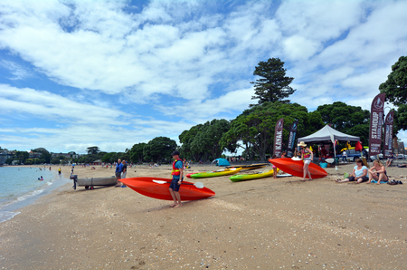 tourist attraction: AUCKLAND - JAN 11 2016:Visitors in Mission Bay Beach.Its one of the most popular beaches and tourist attraction  in Auckland, New Zealand.