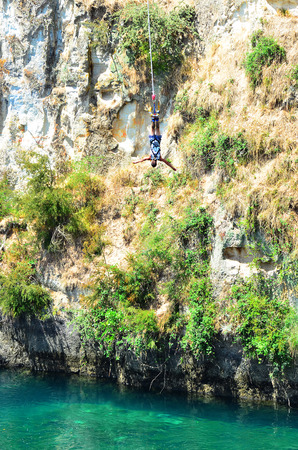 bungee jumping: TAUPO, NZL - JAN 14 2016:Person during bungy jump from 47 metres (154 feet) in above the Waikato River in Taupo, New Zealand. Editorial