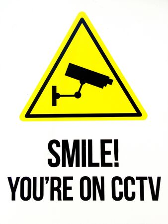 under surveillance: Sign reads: Smile you are on CCTV. Security concept