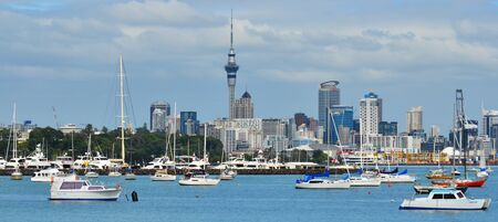 owning: AUCKLAND - JAN 11 2016:Panoramic view of Auckland city skyline.One of Aucklands nicknames is the City of Sails from the popularity of sailing in the region as 1 in 3 Auckland households owning a boat Editorial