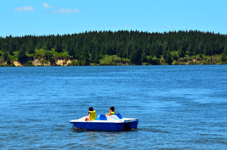 MANGAKINO, NZL - JAN 15 2016:Pedal boat on Lake Maraetai.It's artificial lakes formed as part of a hydroelectricity scheme on the Waikato River in the North Island of New Zealand.