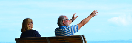 care about the health: AUCKLAND - JAN 11 2016:Retired couple daydreaming. About 40 million senior citizens live in the USA today and aging population impact everything from housing and health care to travel and employment.