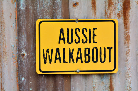 Aussie walkabout sign on an old barn wall. Stock Photo