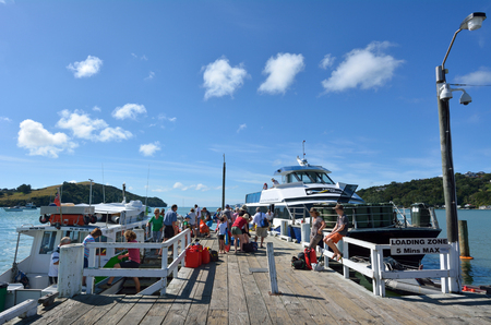two and two thirds: WARKWORTH, NZL - JAN 25 2016:Ferries in Sandspit Wharf to Kawau Island, New Zealand.Kawau Island is an Historic Reserve and home to kiwi and two thirds of the entire population of North Island weka. Editorial
