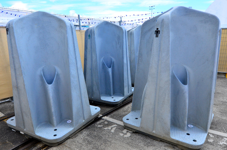 watercloset: A public outdoors men urinal units.