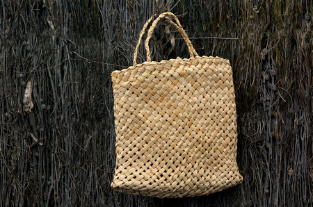 maori: Woven flax bag (close up ) traditional Maori culture artwork New Zealand. Stock Photo