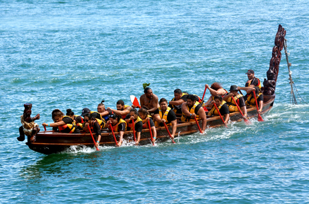 maori: AUCKLAND, NZL - JAN 30 2016:Maori waka heritage sailing in Auckland, New Zealand. Maori watercraft, usually used for fishing and river travel and war canoes can reach up to 40 metres 130 ft long.