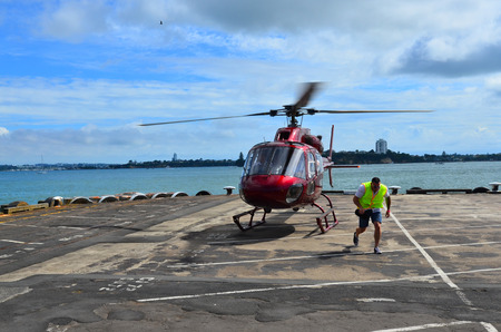 helipad: AUCKLAND - JAN 31 2016:Helicopter landing pad.While helicopters are able to operate on a relatively flat surfaces, helipad provides a clearly marked hard surface where a helicopter can land safely.