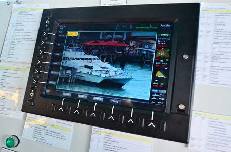 border patrol: AUCKLAND - JAN 30 2016:Surveillance camera monitor on patrol boat. Its commonly engaged in border protection roles as: anti-smuggling, anti-piracy, fisheries patrols, and immigration law enforcement. Editorial