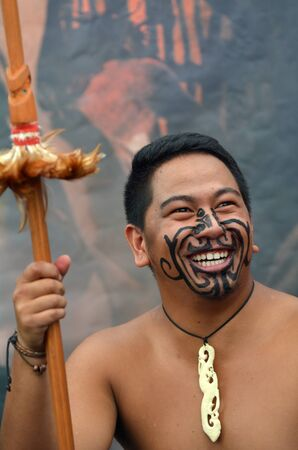 migrated: AUCKLAND,  NZL - JAN 30 2016:Maori man smile. Maori are the indigenous people of New Zealand that migrated to New Zealand from Polynesia1000 years ago.