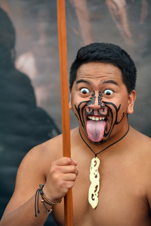 AUCKLAND,  NZL - JAN 30 2016:Maori man in traditional greeting.Maori are the indigenous people of New Zealand that migrated to New Zealand from Polynesia1000 years ago. Editorial