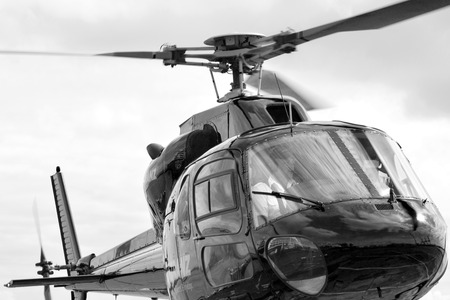faa: AUCKLAND,  NZL - JAN 31 2016:Commercial civilian helicopter pilot. According to FAA  pilot must fly 150 solo hours before he qualify for commercial helicopter license.