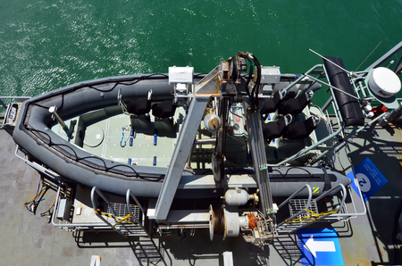 defense facilities: AUCKLAND - JAN 30 2016:Combat Rubber Raiding Craft on a battleship.It used by navy for transportation of lightly armed raiding parties or reconnaissance teams onto offshore facilities and vessel.