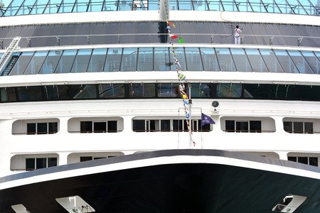 retiring: AUCKLAND - JAN 31 2016:Worker cleans cruises ship windows.A 2004 study show that retiring to a cruise ship was as cost effective as retiring to a retirement home but with better quality of life. Editorial