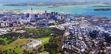 AUCKLAND - JAN 31 2016:Aerial view of Auckland War Memorial Museum against  Auckland financial center. Auckland is the financial capital of new Zealand