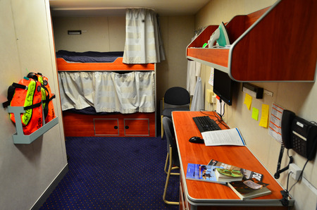 bunk: AUCKLAND,  NZL - JAN 30 2016:interior of a living cabin with bunk beds on Naval ship patrol boat.Sailors are used to sleeping in small bunks, or on deck with or without a cushion. Editorial