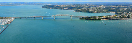 eye traveller: AUCKLAND - JAN 31 2016:Aerial view of Auckland harbour bridge.  It is the second-longest road bridge in New Zealand, and the longest in the North Island.