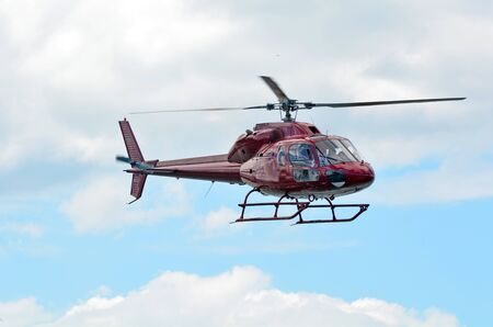 gusty: AUCKLAND - JAN 31 2016:Helicopter Hovering in the air.Hovering can be the most difficult skill when flying a helicopter. Constant control is required to offset gusty air created by the helicopter.
