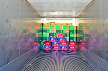 allowing: AUCKLAND - JAN 30 2016:Boxes in a refrigerated container.It allowing world consumers to enjoy fresh produce at any time of year and consume unavailable fresh produce from other parts of the world.