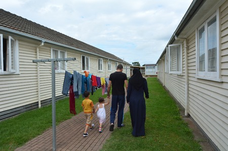 war refugee: Auckland, New Zealand - February 21, 2016: A Syrian refugee family walk through the Mangere Refugee Resettlement Centre.New Zealand annual intake is 750 refugee fleeing war in Syria.