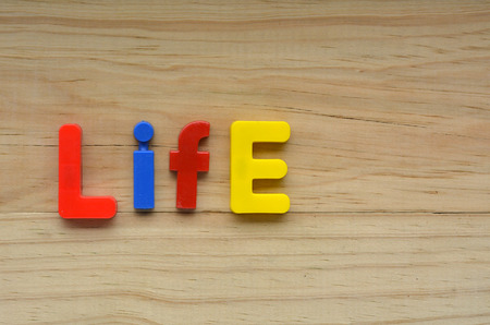 entities: Flat lay of the word Life on a wooden background.  Relationship concept with copy space for text Stock Photo