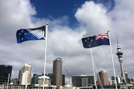 AUCKLAND - FEB 21 2016:New Zealand National flag R and the Silver Fern flag L. After the final referendums voting in the end of March 2016 one of the flags will be the official flag of New Zealand