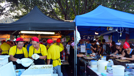 culinary tourism: AUCKLAND - FEB 20 2016:Chinese cuisine food market.In China, today, people eat almost twice as many grams of produce per day than the average American. Editorial