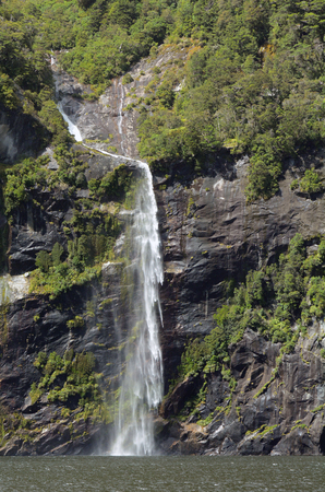 milford: Spectacular waterfall in Milford Sound fiord, New Zealand. Stock Photo