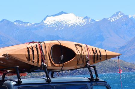 aspiring: Kayaks against snow cap mountains of Mount Aspiring National Park and Wanaka lake in the Otago region of the South Island of New Zealand.