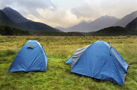 contryside: Two tents in campsite in Fiordland, New Zealand