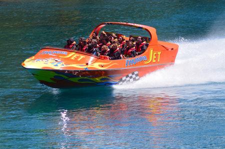 nz: QUEENSTOWN, NZ - JAN 15:Tourists enjoy a high speed jet boat ride on Jan 15 2014 in Queenstown, New Zealand. Queenstown is one of the most popular summer and winter resort in NZ.