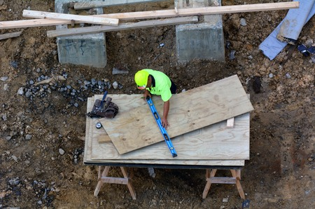 illegal immigrant: AUCKLAND - MAR 03 2016:Construction worker.US employers often commit wage theft and violation of workplace standards crimes to illegal immigrant workers, because of their questionable legal status.