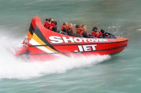 nz: QUEENSTOWN, NZ - JAN 16:Tourists enjoy a high speed jet boat ride on the Shotover River on Jan 16 2014 in Queenstown, New Zealand. Queenstown is one of the most popular summer and winter resort in NZ. Editorial