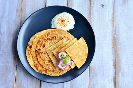 pakistani food: Paratha flatbread Indian cuisine. Food background and texture Stock Photo