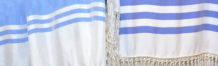 jews: Tallit,  a fringed garment traditionally worn by Jews during Shabbat holidays service pray. Abstract background texture Stock Photo