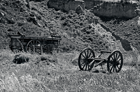 depict: OTAGO, NZ - JAN 17:AOld wagons in Goldfields Mining Centre on Jan 17 2014, historic reserve protected by NZ Department of Conservation, depict the lifestyle of Otagos early goldminers.(BW)