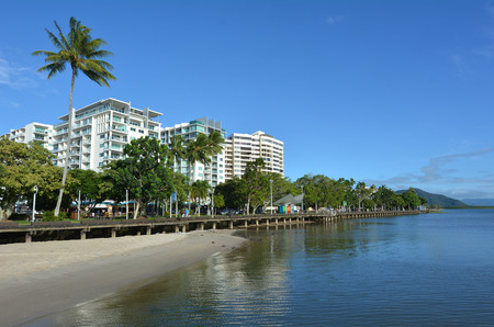 cairns: Cairns waterfront skyline in Queensland Australia at high tide.