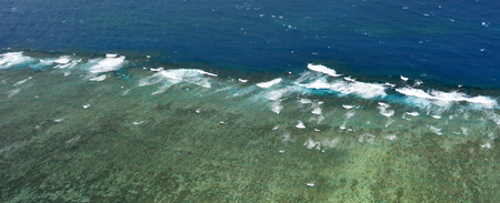 great barrier reef marine park: Aerial view of waves break onto Moore coral at the Great Barrier Reef near Cairns in Tropical North Queensland, Queensland, Australia.