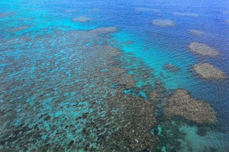 barrier: Aerial view of Moore coral reefs at  the Great Barrier Reef near Cairns in Tropical North Queensland, Queensland, Australia. Stock Photo