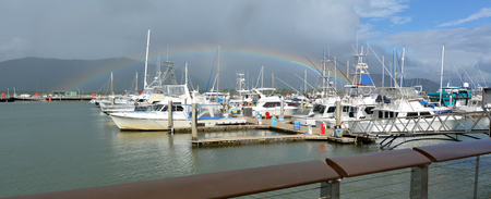 cairns: Rainbow over Cairns Marlin Marina in Queensland Australia