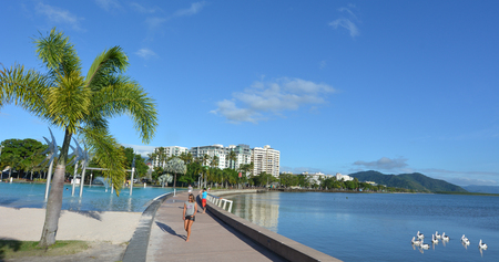 tropical climate: CAIRNS, AUS - APR 15 2016:Cairns skyline. Cairns city is the 5th most populous in Queensland and a popular tourists travel destination for its tropical climate and access to the Great Barrier Reef.