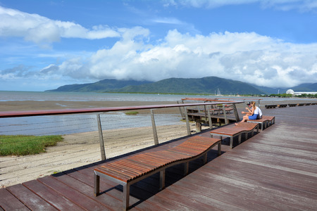 cairns: CAIRNS, AUS - APR 14 2016:Visitors at Cairns Esplanade, a very popular tourist travel destination in Cairns Queensland, Australia.