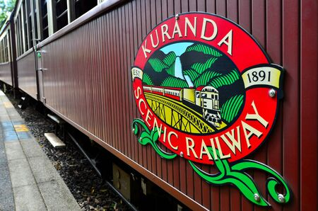 cairns: CAIRNS, AUS - APR 17 2016: Kuranda Scenic Railway train, a very popular tourist attraction in the tropical north of Queensland Australia Editorial