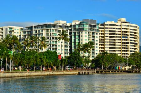 tropical climate: CAIRNS, AUS - APR 15 2016:Holiday apartment buildings in Cairns Queensland Australia. Cairns is a popular travel destination for tourists because of its tropical climate and access to the Great Barrier Reef
