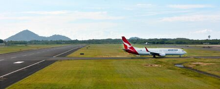cns: CAIRNS, AUS - APR 23 2016:Qantas plane in Cairns Airport, Queensland Australia.  The airport is a major port for the flag carrier airline of Australia and largest airline by fleet size, Qantas. Editorial