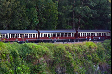 cairns: CAIRNS, AUS - APR 17 2016:Passengers on Kuranda Scenic Railway in the tropical north of Queensland Australia