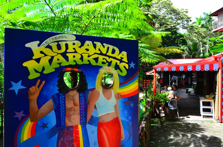 tableland: CAIRNS, AUS - APR 17 2016:Cut out face poster of hippie people at the Original Rainforest  Market a popular travel destination in Kuranda at the Atherton Tableland tropical north of Queensland, Australia