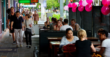 tropical climate: CAIRNS, AUS - APR 14 2016:People visiting in Cairns,  the 5th most populous city in Queensland Australia and a popular tourists travel destination for its tropical climate and access to the Great Barrier Reef. Editorial