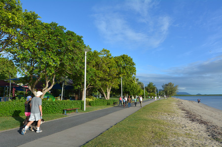 cairns: CAIRNS, AUS - APR 15 2016:People walks on Cairns Esplanade, a very popular tourist travel destination in Cairns Queensland, Australia.