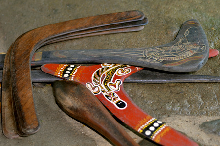 boomerangs: QUEENSLAND - APR 16 2016:Indigenous Australian art Dot painting on  boomerangs. Its one of the oldest traditional form of art in the world. Paint marks to tell Aboriginal myths and legends Editorial